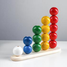 Abacus pyramid with balls