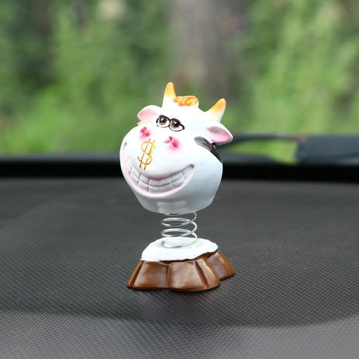 Игрушка на панель авто, бык качающий головой