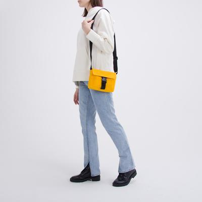 Bag on a strap with a clasp