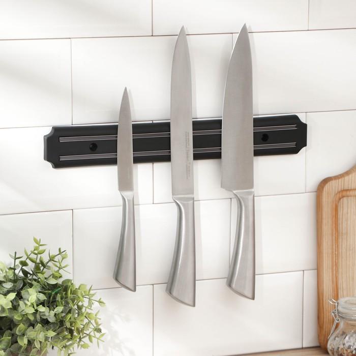 представляет собой магнит для крепления кухонных ножей фото них