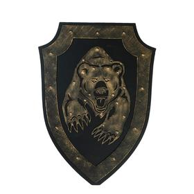 A souvenir on the wall a Shield with a Bear