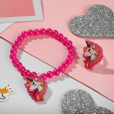 "A set of children's ""Vibracula"" 2 pre-TA: bracelet, ring, unicorn, MIX color"