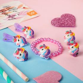 A set of 5 items for children: 2 hairpins, a bracelet, clips, a ring