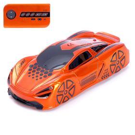 Antigravitational machine Racer, radio control, battery, rides wall, orange color