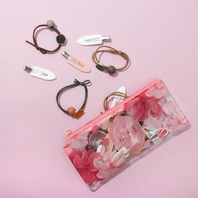 A set of rubber and hairpins in the cosmetic bag