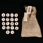 "A set of ""Slavic Runes"" on the cut Maple wood"