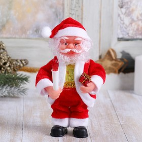 Santa Claus with candle and bell