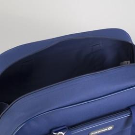 Travel bag, zip closure, 2 outer pockets, long belt, color blue.