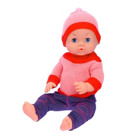 Baby doll in a knitted outfit with accessories, drinks from a bottle, writes in a pot, sound effects